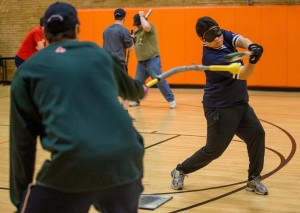 Joe Quintanilla takes a cut off the hit stick indoors in Brighton