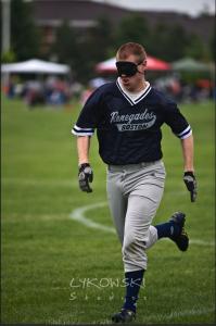 Joe McCormick flies toward a base
