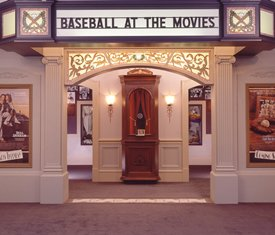 "Picture of  a box office showing ""baseball at the movies"" as the show"