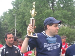 Photo of Renegades player Evan Silver holding up a trophy
