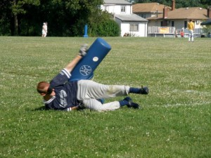 Photo of Joe McCormick sliding into base