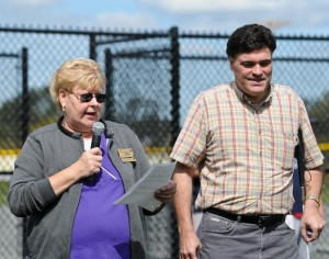 Paula Lehtola, past president of the Bridgewater Academy Lions Club, welcomes all and introduces John Oliveria, president of the Association of Blind Citizens, at the start of the Beep Ball game on a Saturday afternoon in September of 2011