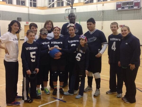 Pictured are Renegade coach Kara Peters, Joe Quintanilla and Larry Haile with the players and coaches from the VIStars.