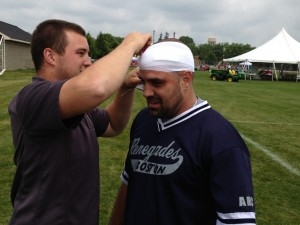 Rob Dias is attended to after gashing his head on defense in the 5th inning
