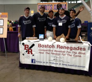 The Renegades pose behind their table at the Abilities Expo