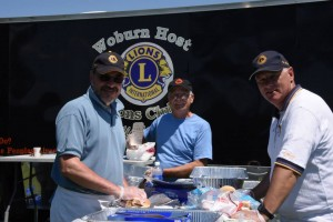 Three members of the Woburn Host Lions man  the food truck at the Beast of the East