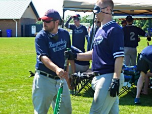 Tim Syphers working the on deck circle during our game against the Bayou City Heat as he helps Joe McCormick get his bat