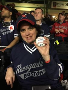 Melissa Hoyt holds the ball she threw out for the first pitch at Fenway