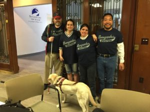Rob, Daisy, Melissa and Yee educate the public about the beep baseball