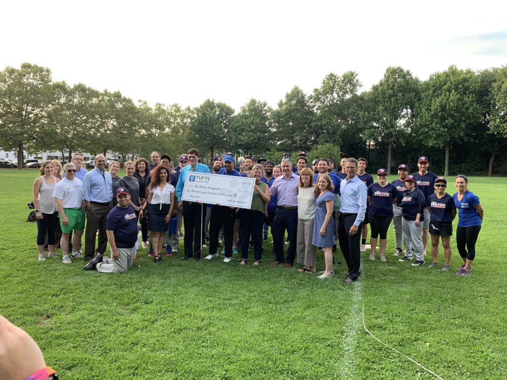 Picture of Tufts Health Plan presenting a check for $2,500 to the Renegades